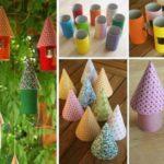 Pequeñas casa colgantes realizadas con rollo de cartón y bonetes para decorar el jardín
