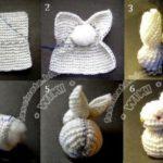 Simpático conejo tejido realizado con lana para el bebé de la casa