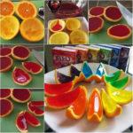 ¡Postre, colores y niños! Diferentes frutas cubiertas con gelatinas de distinto sabores