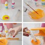 Botellas de vidrio renovadas con acrílicos de diferentes colores para decorar