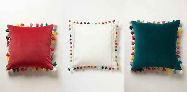 Almohadones coloridos decorados con borlas de hilo para - Como hacer borlas de hilo ...