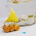 Barquitos de corcho como souvenirs de bautismo